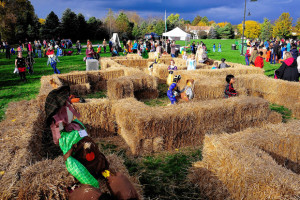 Kids run through a hay maze at Dublin's annual Spooktacular at the Dublin Community Center on Thursday, October 16, 2014.
